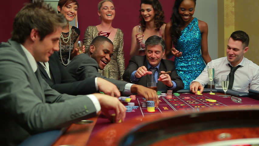a group of people around a casino table