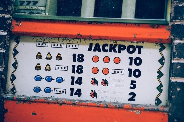 an orange jackpot spin with numbers and fruits