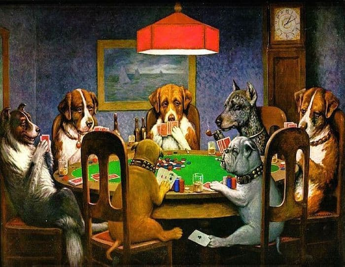 7 dogs sitting around a table and playing poker