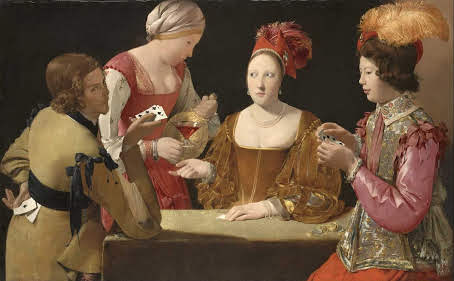 a couple of women playing poker, while a waitress serves wine