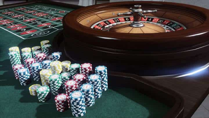 roulette wheel with poker chips next to it in the gta casino