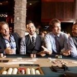 guys sitting around a poker table