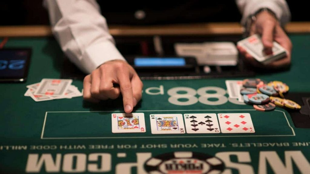 casino dealer placing cards on a casino table