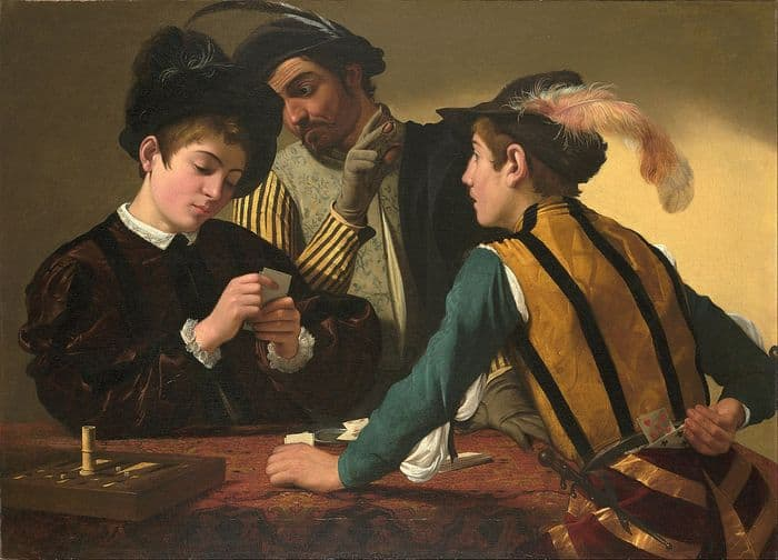 three men playing poker