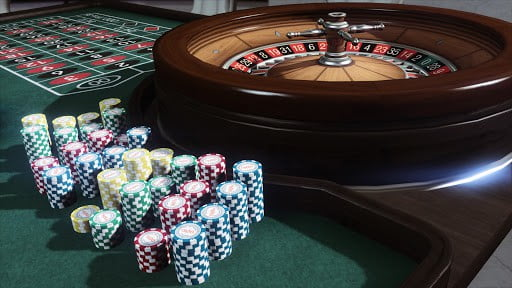 roulette table with poker chips and roulette wheel